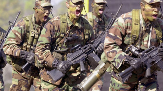 397109 14: A U.S. Army Ranger unit goes through its paces during a demonstration of the elite force November 9, 2001 before a graduation ceremony at Fort Benning in Columbus, Georgia. Rangers have been used in the military actions in Afghanistan. (Photo by Erik S. Lesser/Getty Images)
