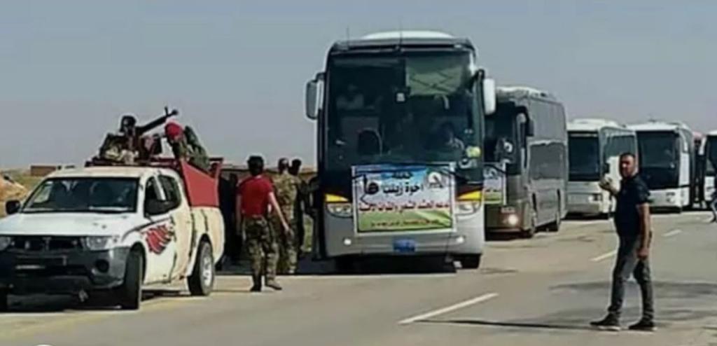 """بالصور.. عشرات الحافلات المحملة بـ """"الحجاج الإيرانيين"""" تصل الميادين"""