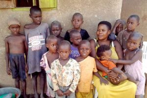 0 PAY The Ugandan woman Mariam Nabatanzi sits in front of the house with twelve of her children in Kasawo