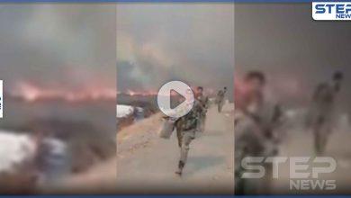 بالفيديو|| عناصر من النظام السوري يقومون بإخلاء مواقع عسكرية طالتها الحرائق في اللاذقية