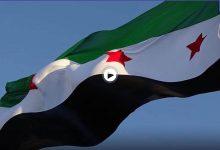 بالفيديو|| مشجع يرفع علم الثورة السورية في مباراة برشلونة وشتوتغارت