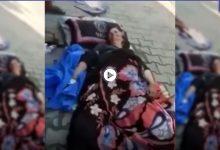 بالفيديو|| امرأة مسنة مرمية أمام مستشفى اليرموك في العراق تصرخ وتطلب المساعدة من المارة تثير الجدل
