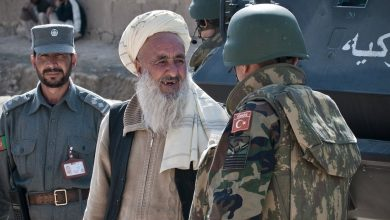 A Turkish Army soldier speaks with a resident in Afghanistan 1