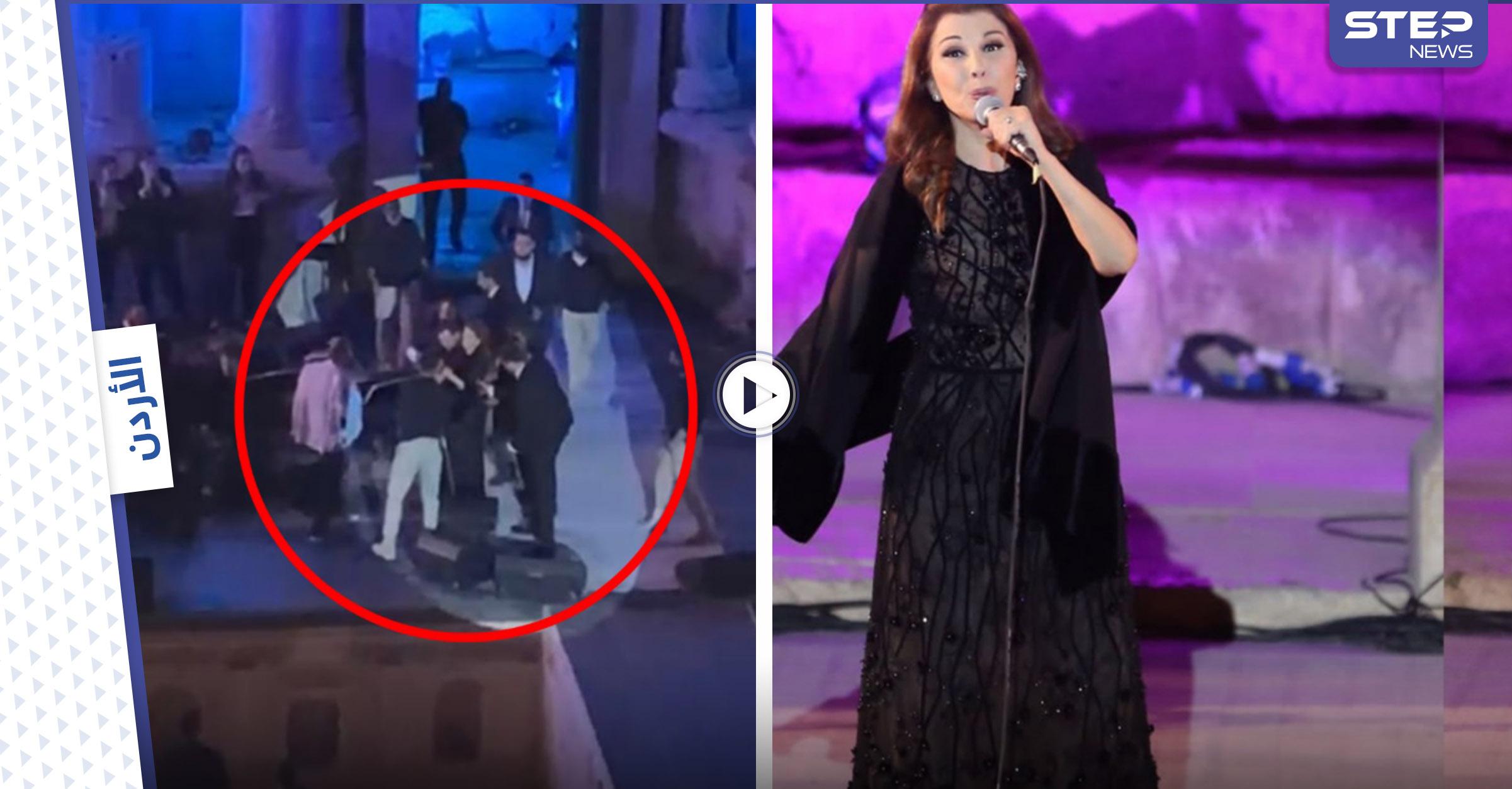 بالفيديو|| شاهد كيف احتضن الموسيقيين والحرس الشخصي ماجدة الرومي لتفادي سقوطها على المسرح وهي تغني بمهرجان جرش في الأردن