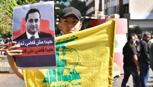 """مراقب سياسي يكشف خطط خطيرة لـ """"حزب الله"""" مع عودة القاضي بيطار إلى التحقيق"""